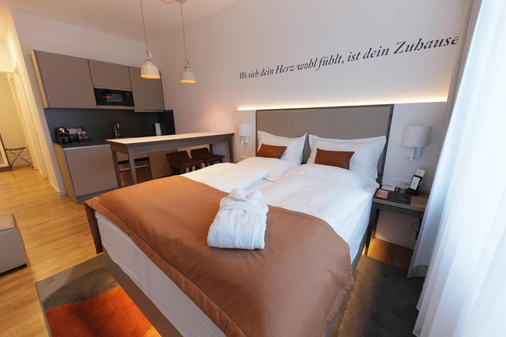 A bed or beds in a room at HighPark by Palmira