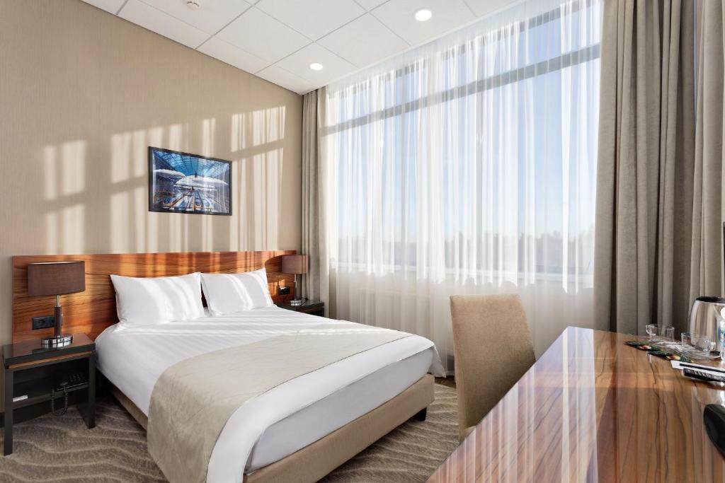 Кровать или кровати в номере Вешки парк Отель