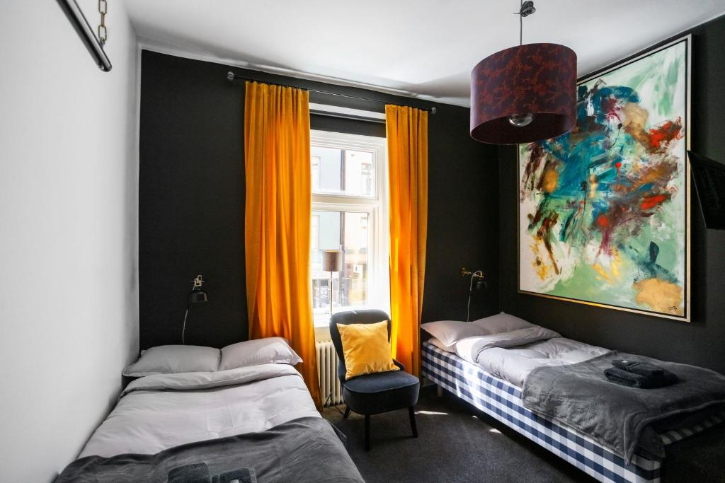 A bed or beds in a room at Eight Rooms