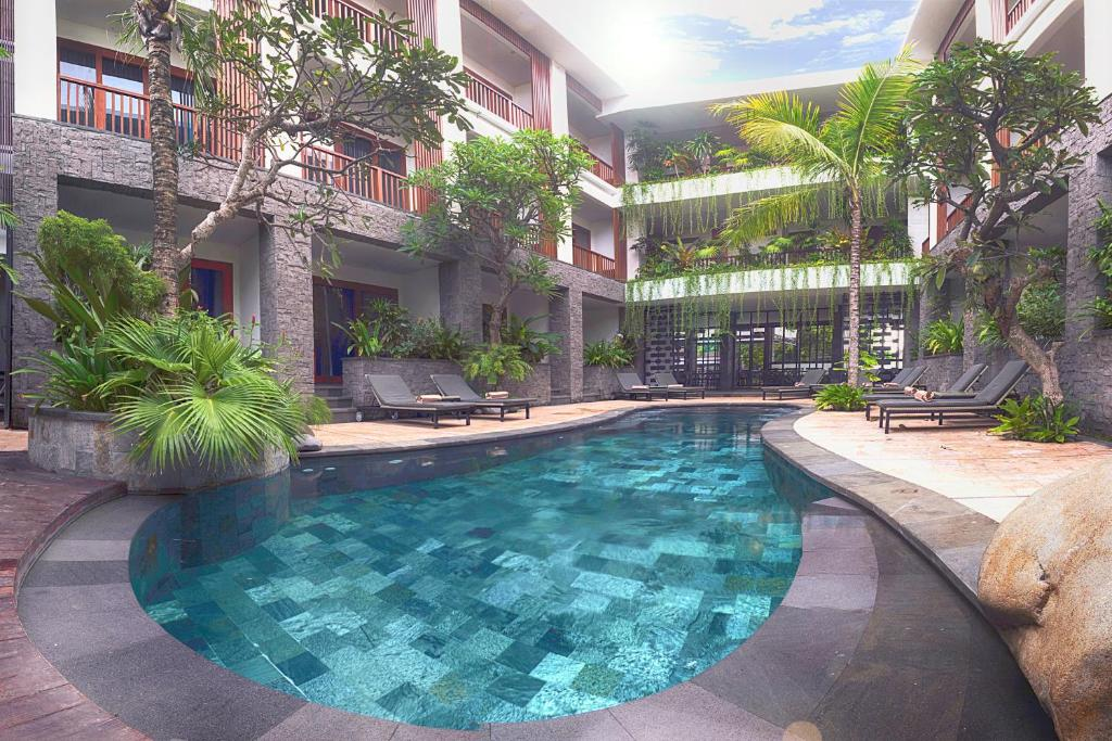 The swimming pool at or near Akana Boutique Hotel
