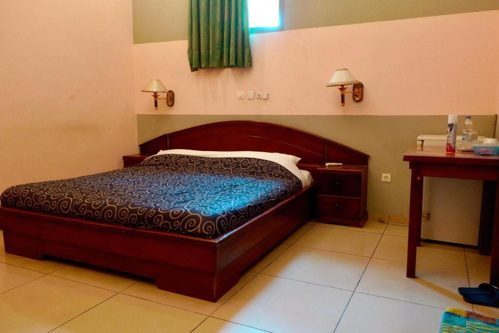 Кровать или кровати в номере Petit Motel Beijing