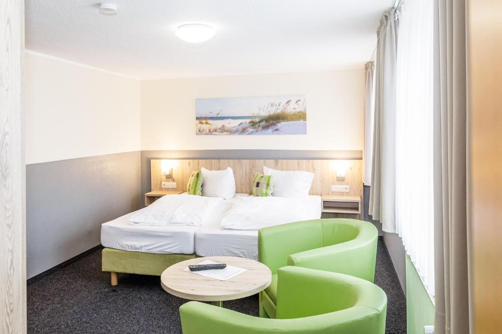 Ein Bett oder Betten in einem Zimmer der Unterkunft Gästehaus Alexandra