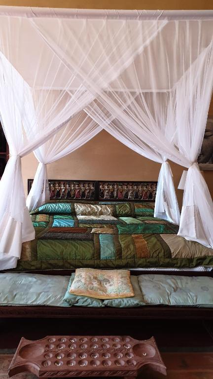 Uma cama ou camas num quarto em Terraço das Quitandas Design GuestHouse