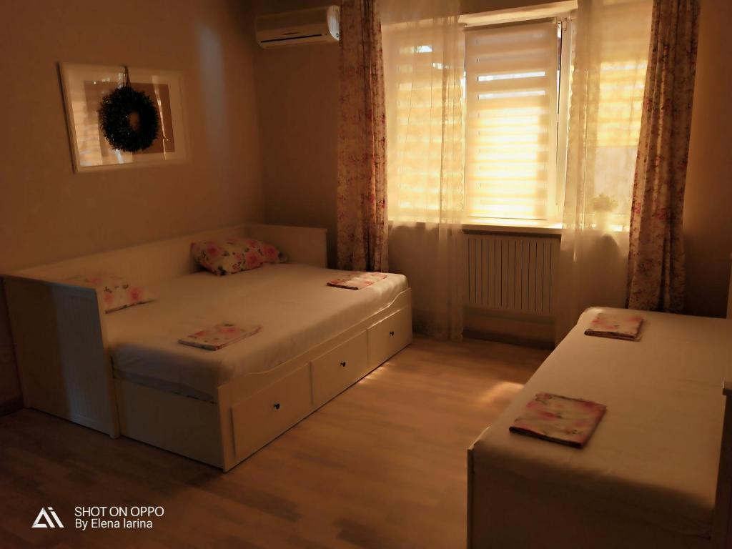 A bed or beds in a room at Guest House Sem&Ya