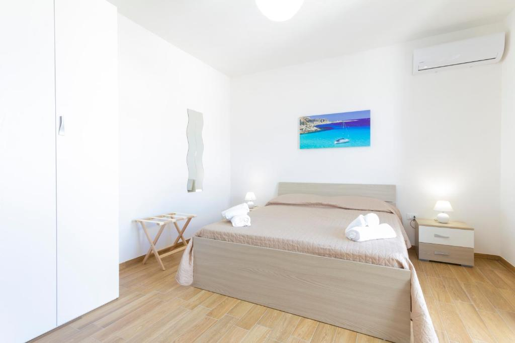 A bed or beds in a room at Vento di Tramontana