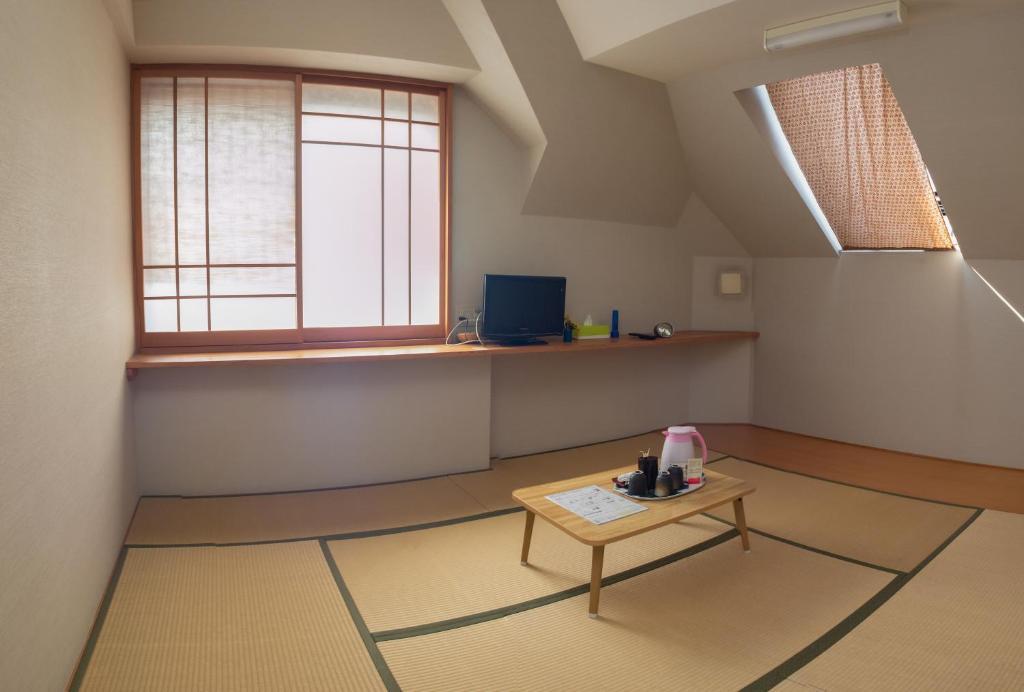 A kitchen or kitchenette at Family Inn Saiko