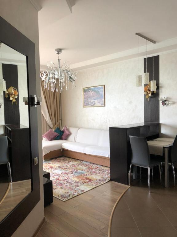 Гостиная зона в Apartament Ideal House