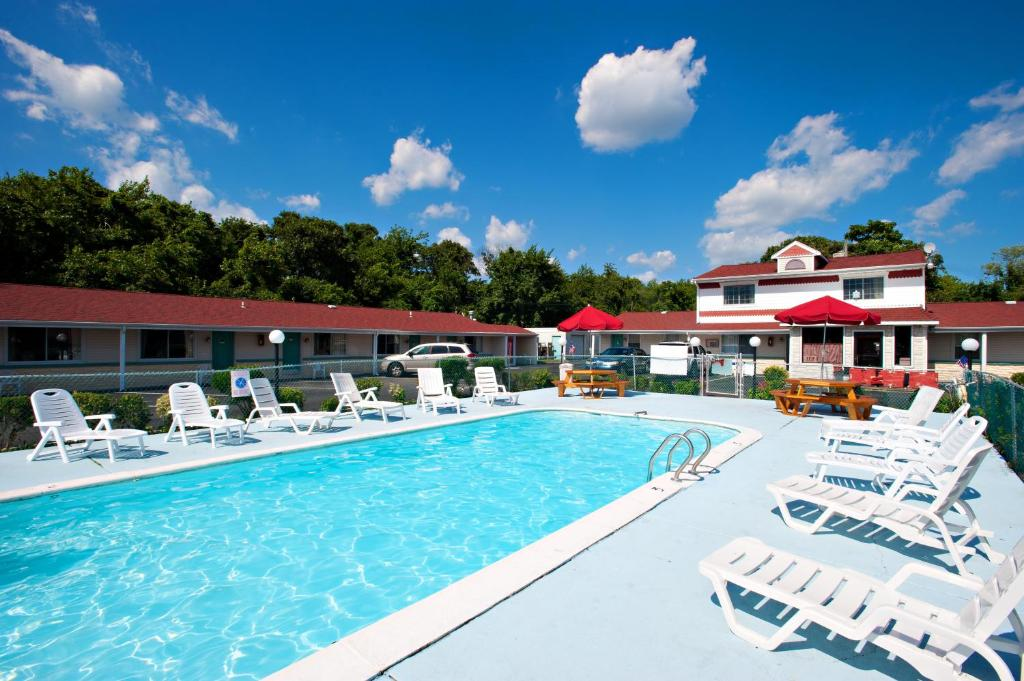 The swimming pool at or near Economy Motel Inn and Suites Somers Point