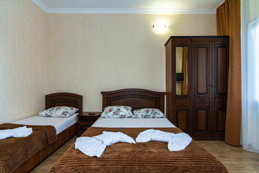 A bed or beds in a room at Zhasmin Guest House