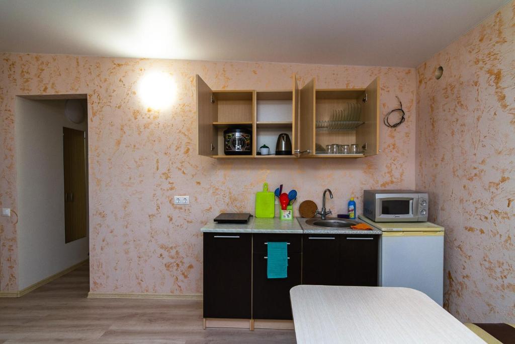 Кухня или мини-кухня в Гостевой Дом Жасмин