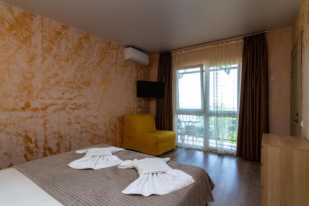 Кровать или кровати в номере Гостевой Дом Жасмин
