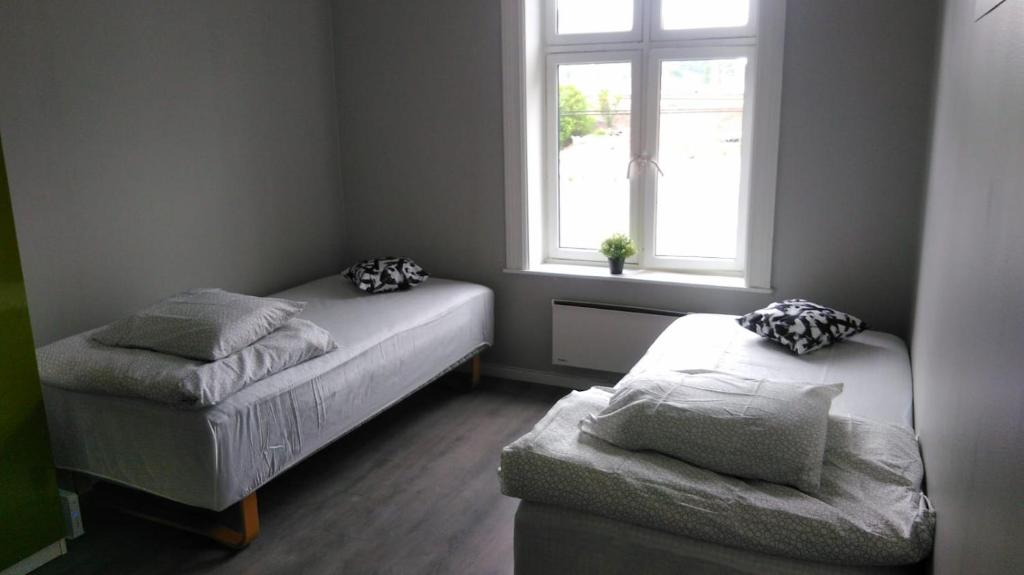 A bed or beds in a room at Center rooms