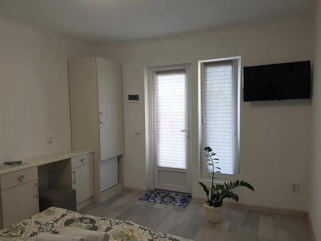 A television and/or entertainment center at Apartments like hotel