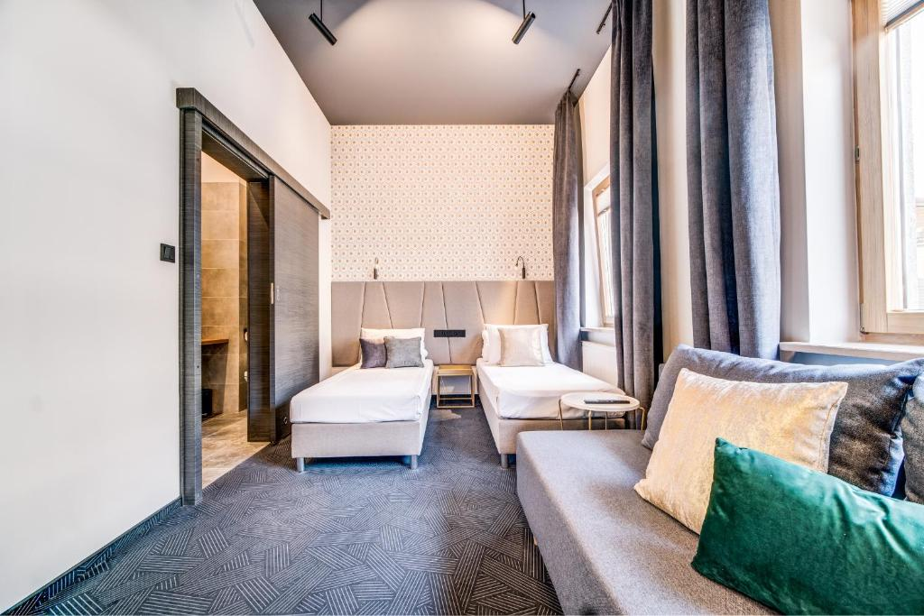 A bed or beds in a room at Rint32