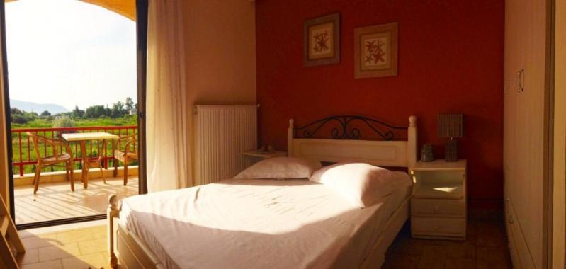 Ένα ή περισσότερα κρεβάτια σε δωμάτιο στο Aenaon Studios