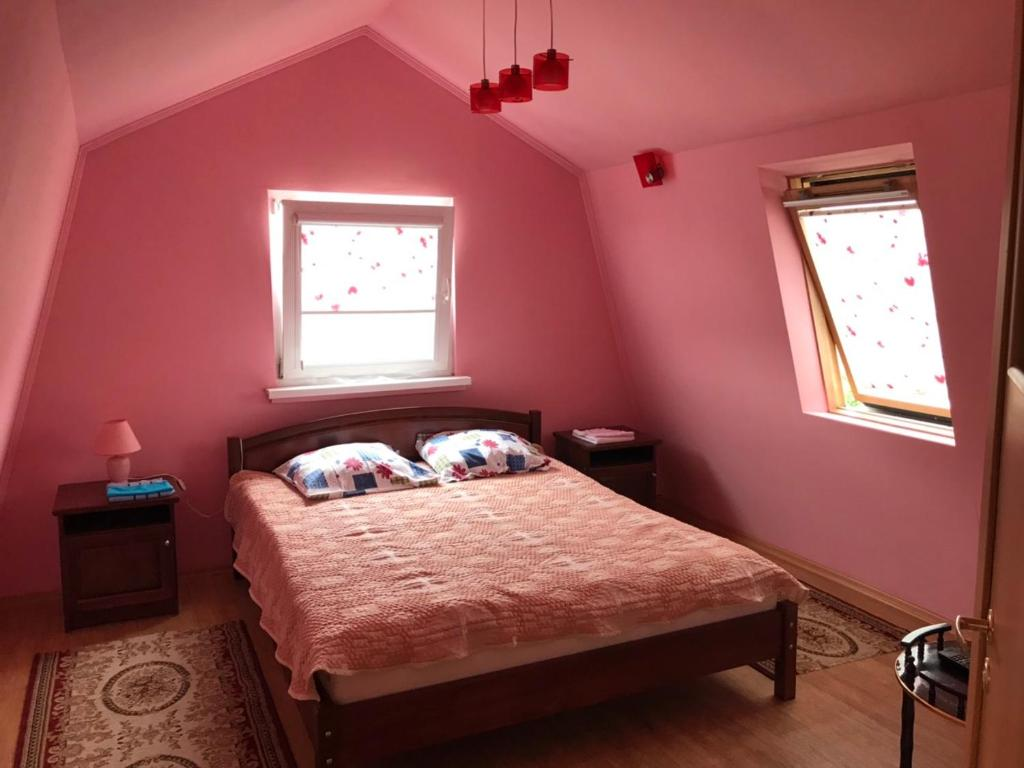 A bed or beds in a room at Победы 27