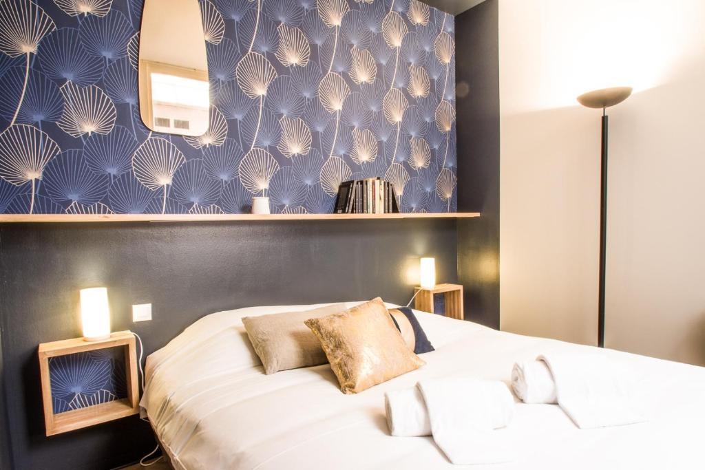 Un ou plusieurs lits dans un hébergement de l'établissement L'Opera by Cocoonr