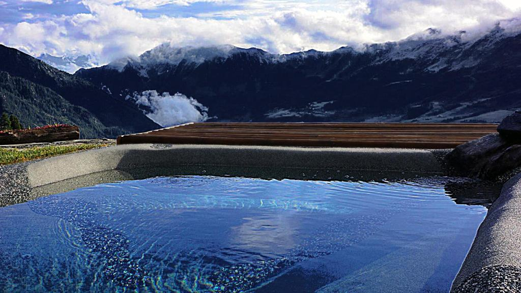 The swimming pool at or near Rifugio Baita Belvedere