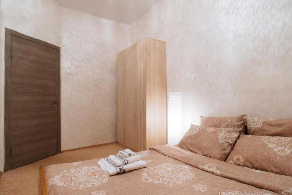 Кровать или кровати в номере Пушкинская,16
