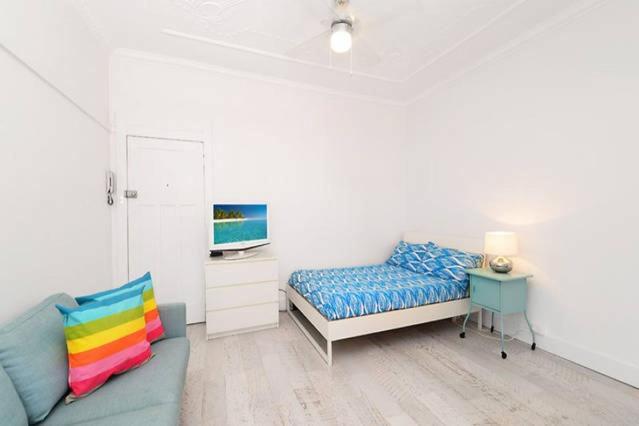 A bed or beds in a room at Centrally located Bondi Beach Studio