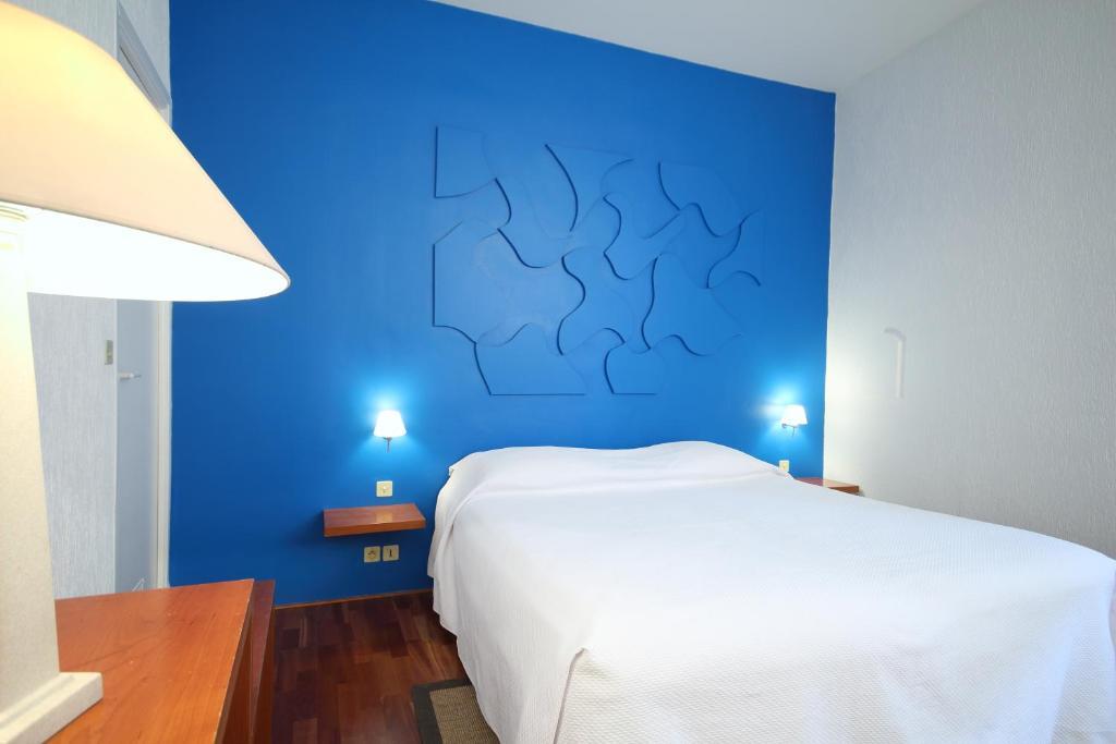 Letto o letti in una camera di Hôtel Windsor