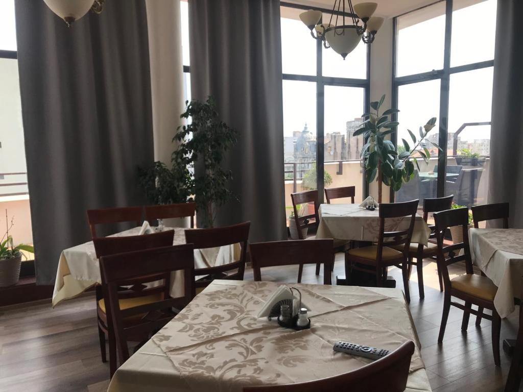 A restaurant or other place to eat at Guci Hotel