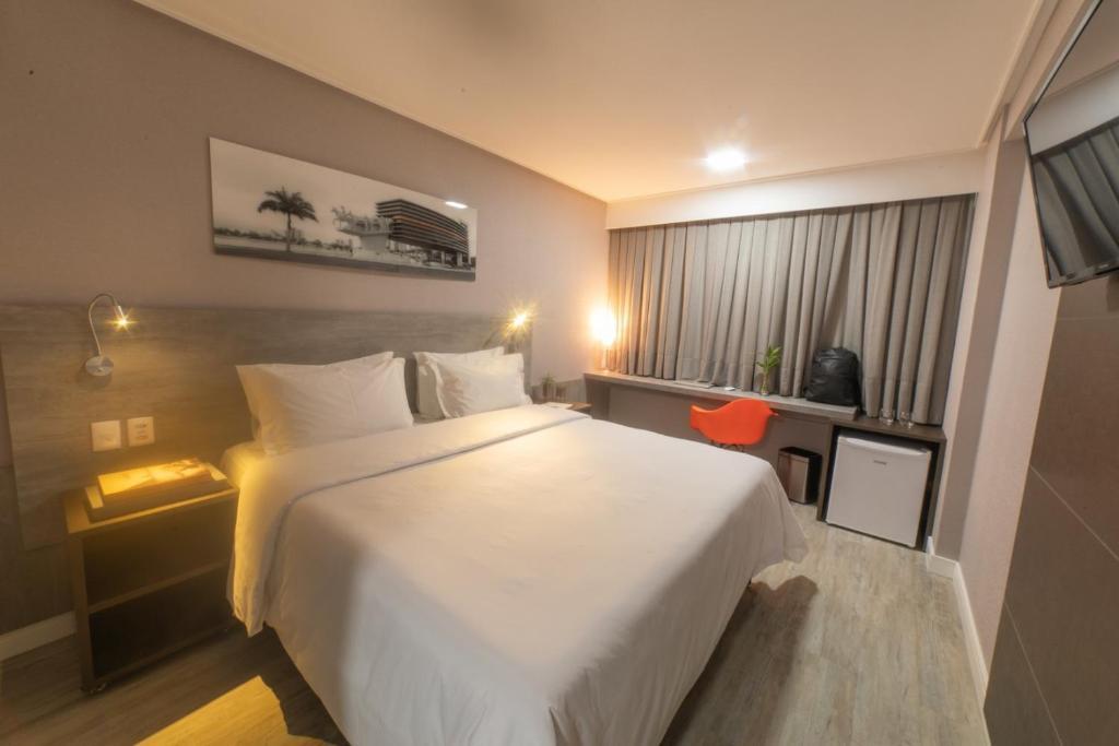 Cama ou camas em um quarto em Intercity Campina Grande Citymix