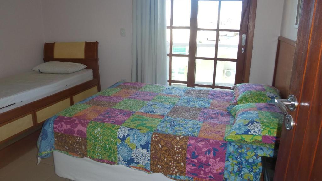 A bed or beds in a room at RESIDENCIAL ARARA AZUL