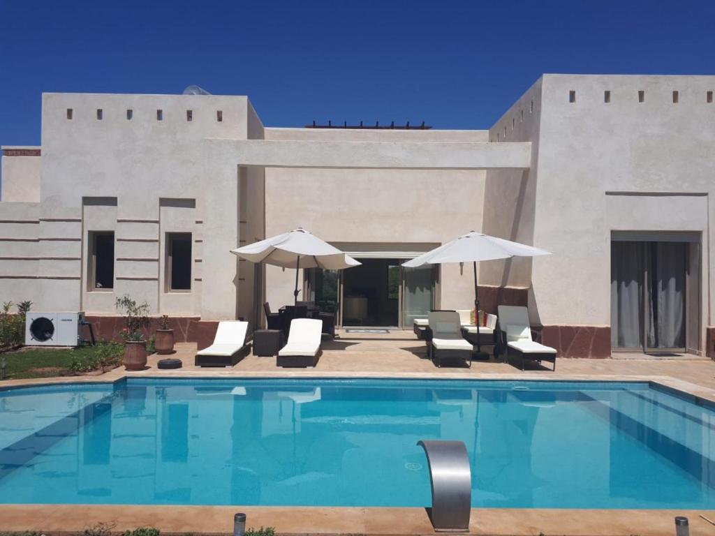 The swimming pool at or near fleur de marrakech