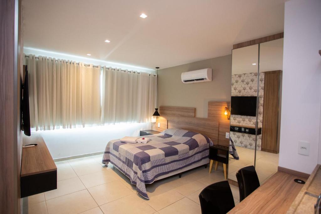 A bed or beds in a room at FLAT CONFORTÁVEL EM BOA VIAGEM