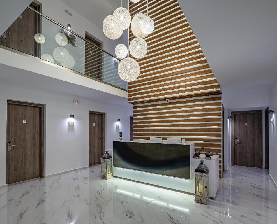 The lobby or reception area at Kyma Rooms & Suites