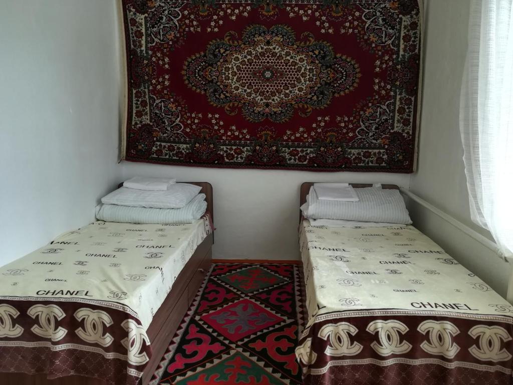 Cama o camas de una habitación en Horseback Holiday at Kyzart village