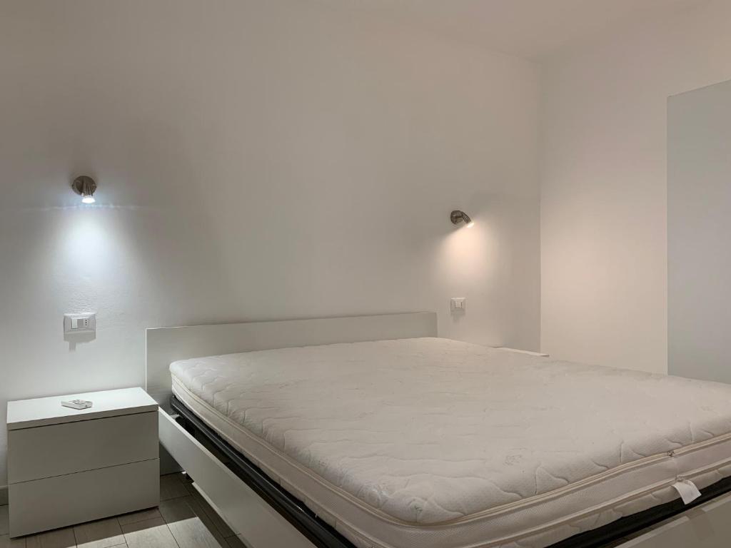 Letto o letti in una camera di Trilocale Porto Azzurro