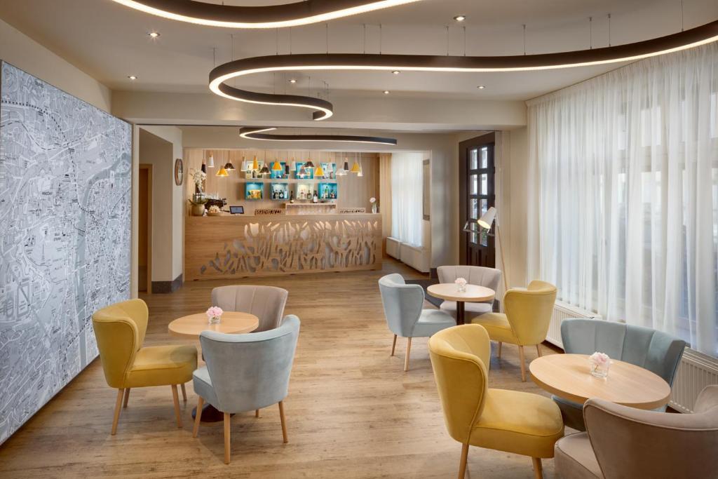 Lounge oder Bar in der Unterkunft Hotel Clement
