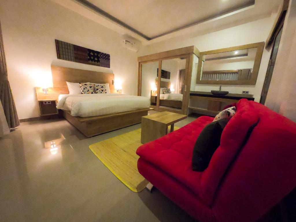 A bed or beds in a room at HI5 Kuta
