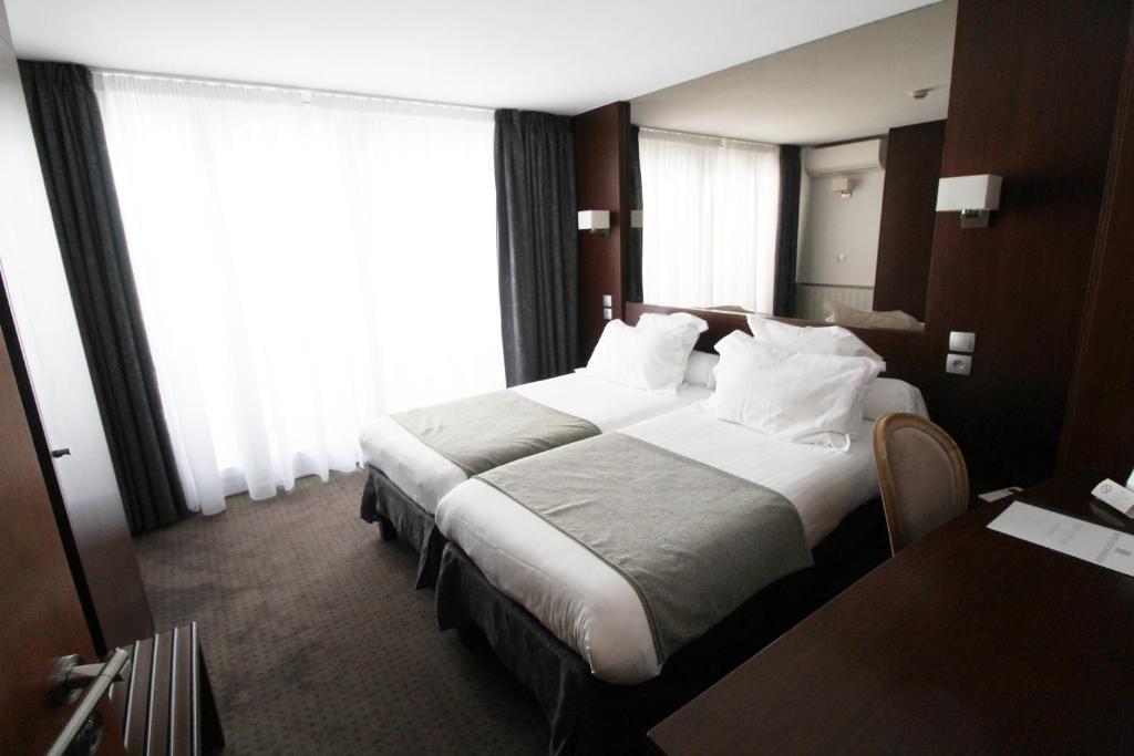 Letto o letti in una camera di Hotel des Tonneliers
