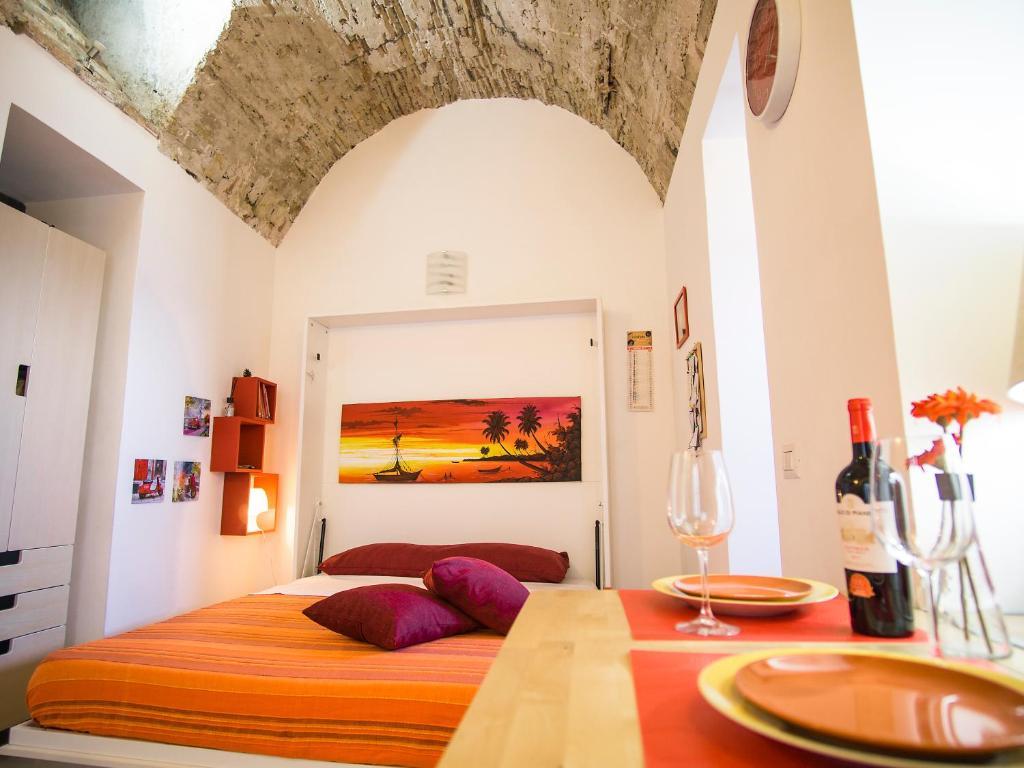 Кровать или кровати в номере La Casa dei Nonni