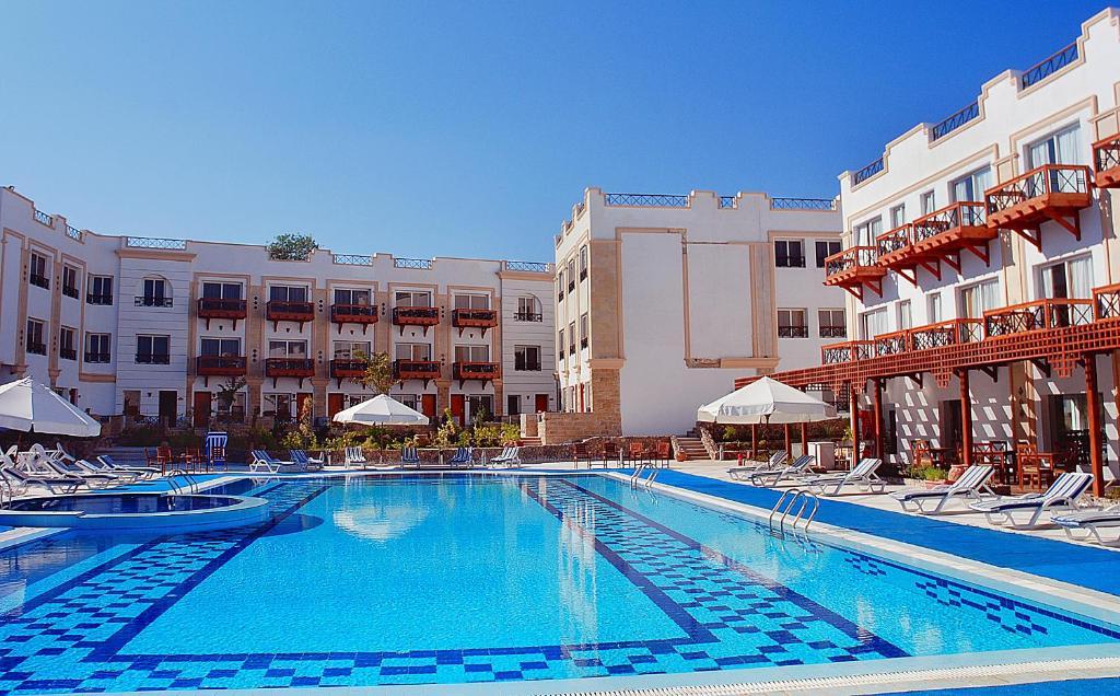 Het zwembad bij of vlak bij Falcon Naama Star Hotel