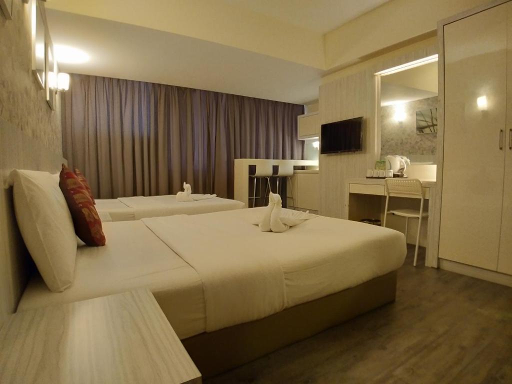 Кровать или кровати в номере Hotel Westree KL Sentral