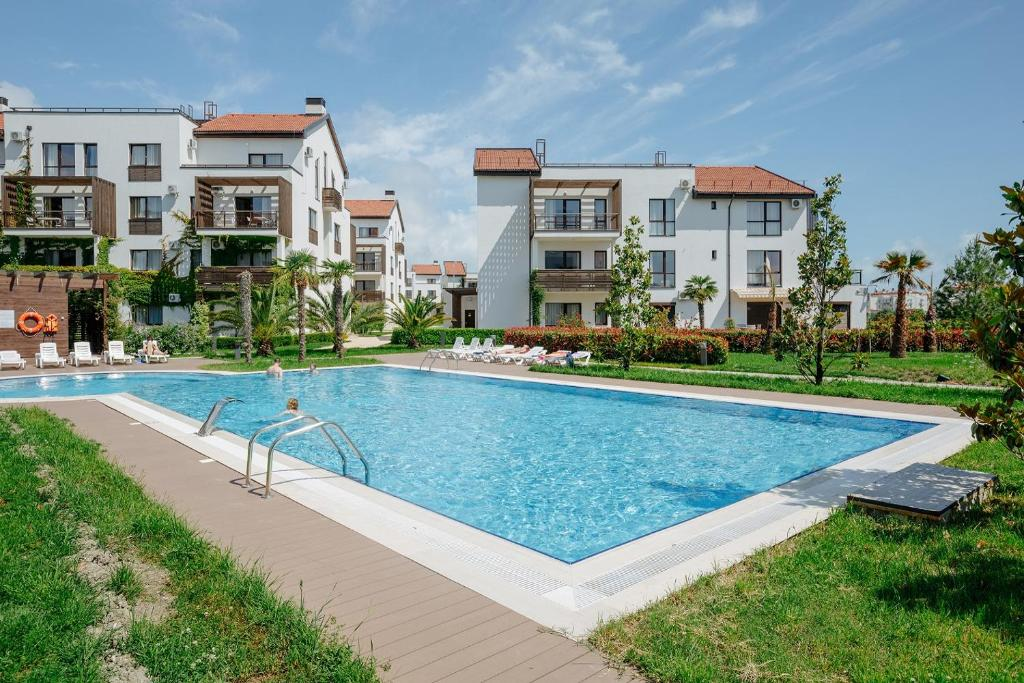 The swimming pool at or near ApartHotel Imeretinsky - Parkovy Kvartal
