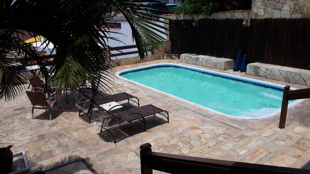 The swimming pool at or close to residence Italia