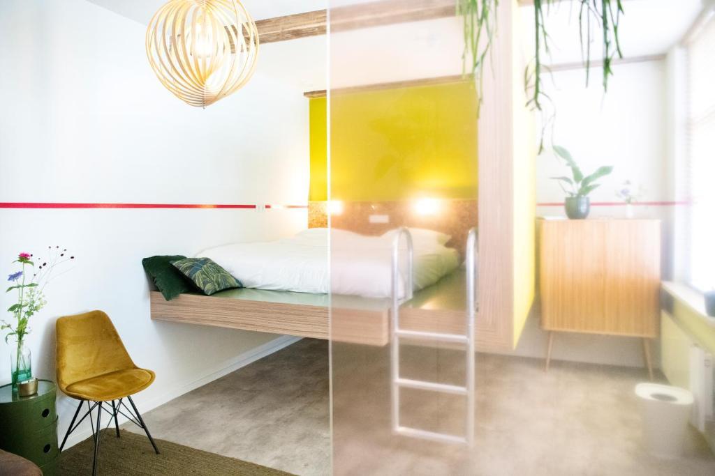 Een bed of bedden in een kamer bij Hotel Bruno