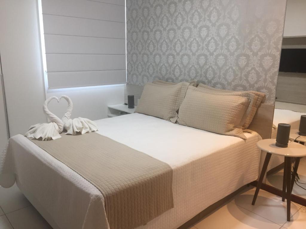 A bed or beds in a room at Apto Luxo Iloa Barra de São Miguel