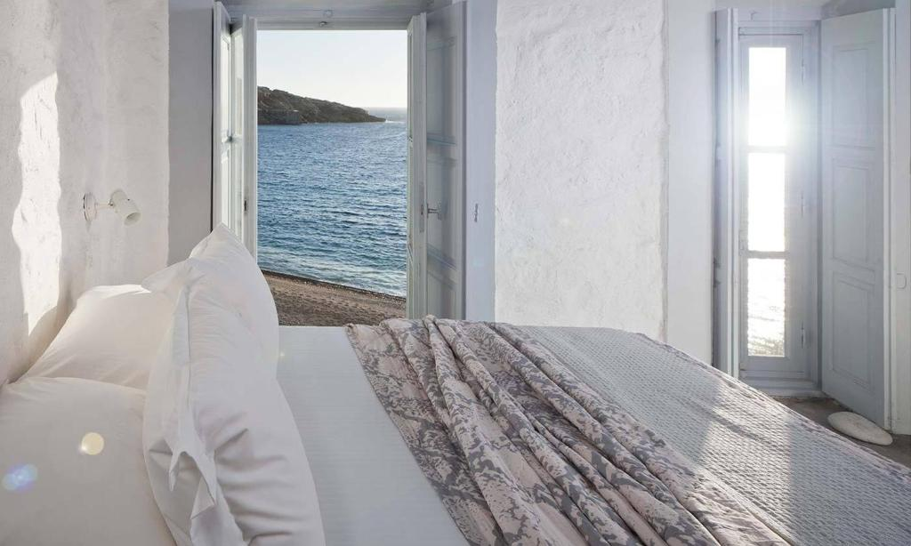 A bed or beds in a room at Coco-Mat Eco Residences Serifos