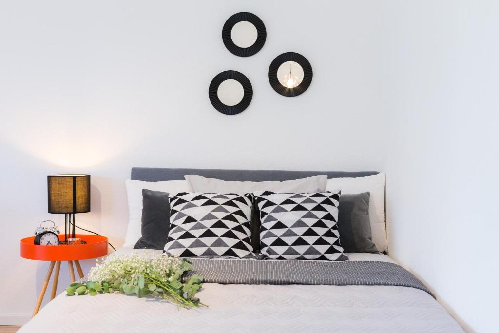 Ein Bett oder Betten in einem Zimmer der Unterkunft Holiday Appartement »Achalm« mit Sonnenterrasse