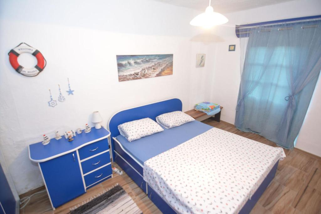 A bed or beds in a room at Apartment Pela