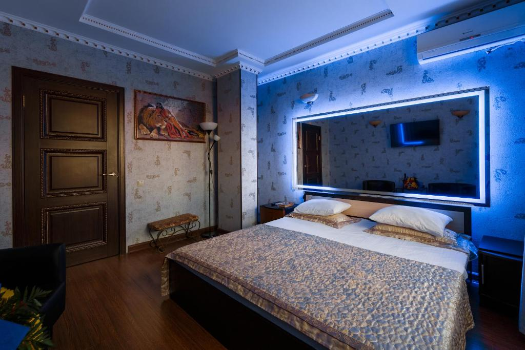 A bed or beds in a room at Otel Nekrasovka