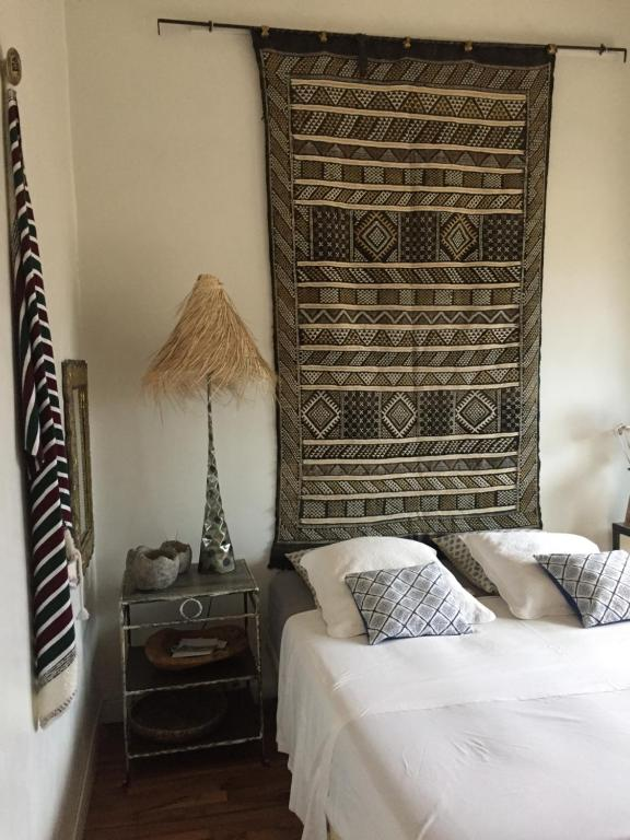 A bed or beds in a room at Le LODGE CABANA