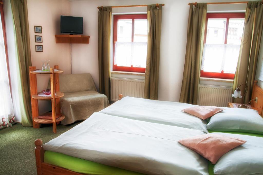 Ein Bett oder Betten in einem Zimmer der Unterkunft Hotel & Restaurant Zum Postillion