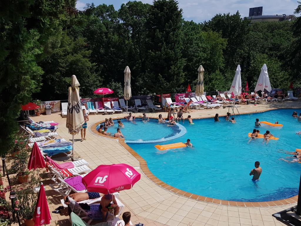 Tintyava park hotel gold strand investment green energy investment agreement terms